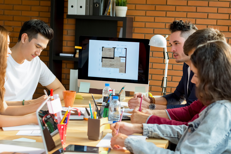 f3 team discussing furniture installation