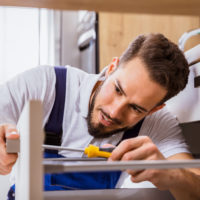 f3 team member repairing student housing furniture